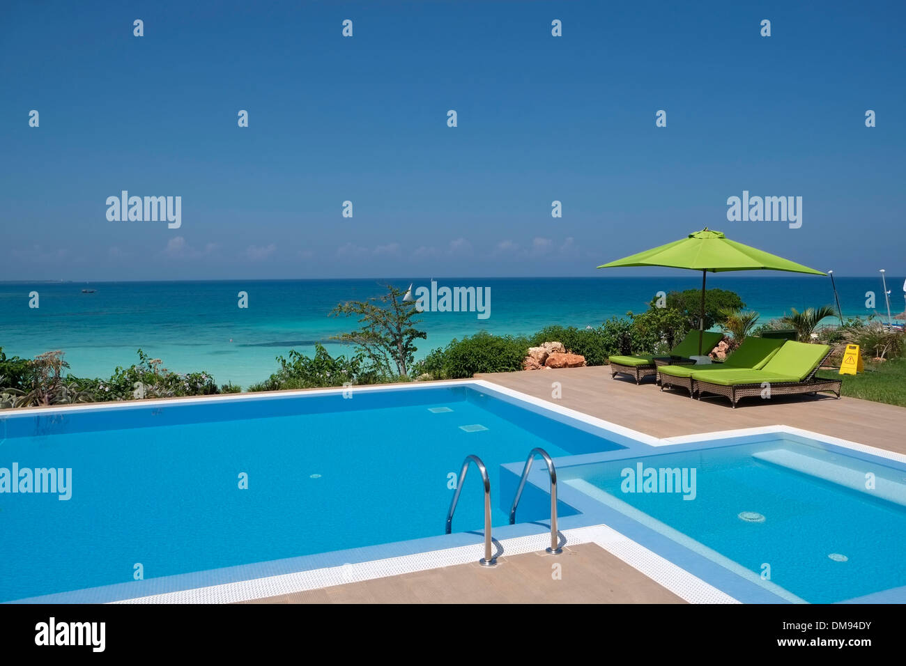 The pool of the Presidential Suite in Hideaway of Nungwi Resort hotel on the north-west coast of Zanzibar island a semi-autonomous part of Tanzania, in East Africa - Stock Image