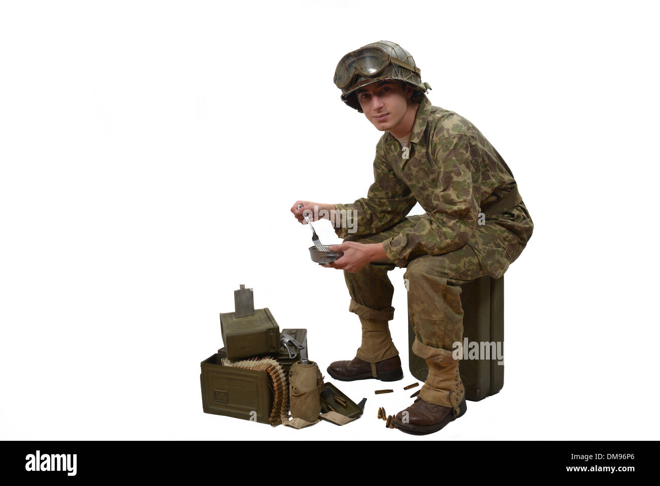 young American soldier in camouflage uniform, takes his meals - Stock Image