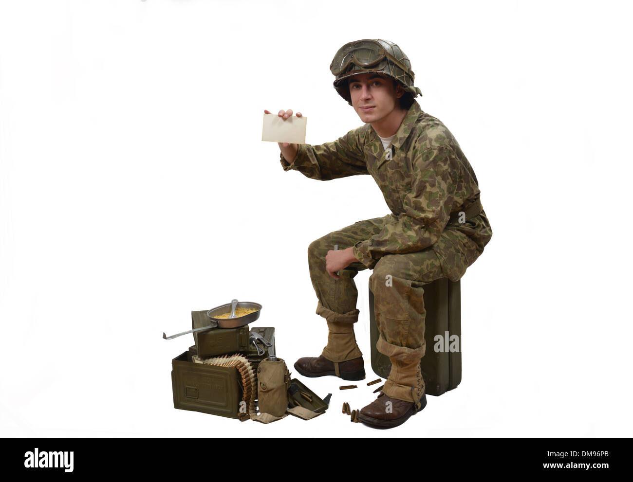 young American soldier in camouflage uniform shows a photograph - Stock Image