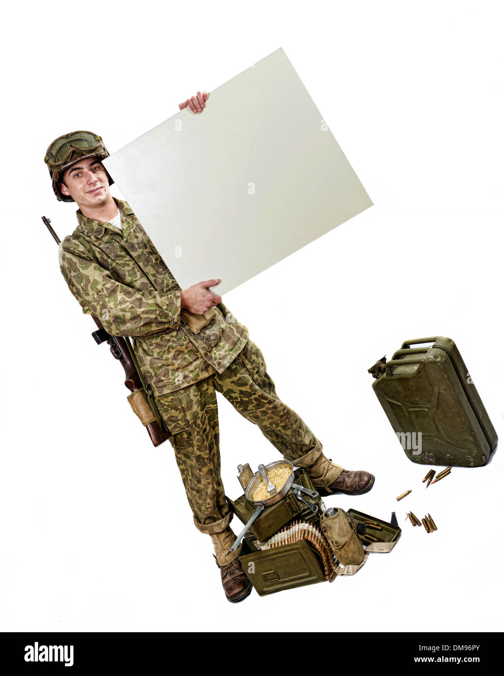 young American soldier in camouflage uniform shows a sign - Stock Image