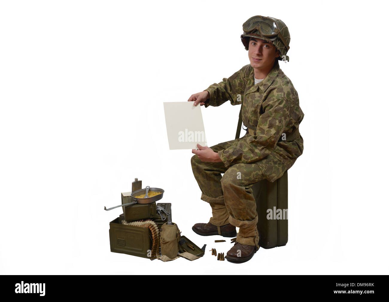 young American soldier in camouflage uniform shows a letter - Stock Image