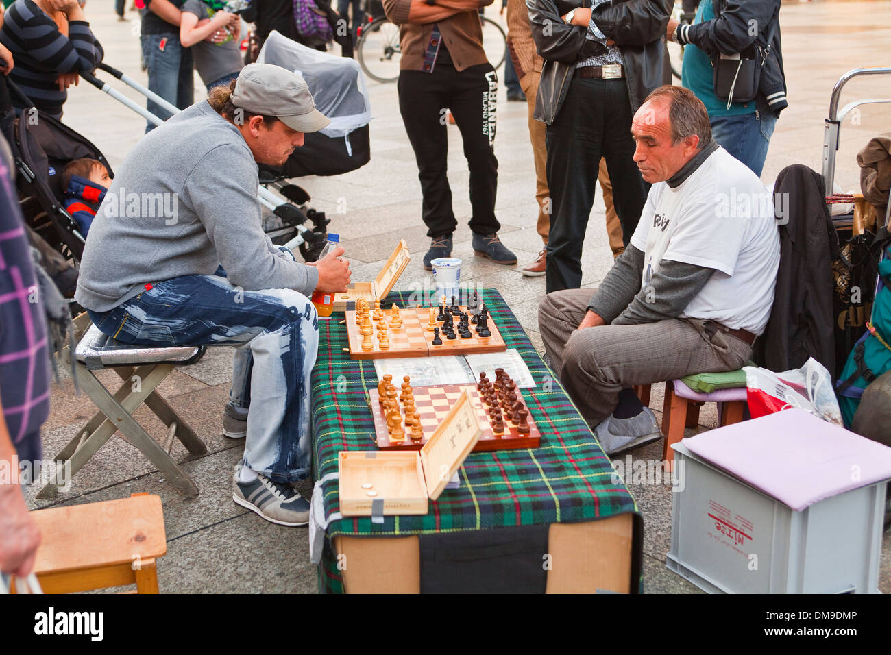 Men playing chess in the streets of old Cologne. - Stock Image