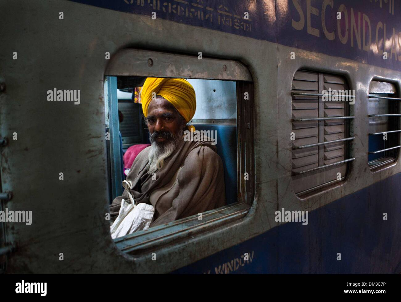 (131213) -- PUNJAB, Dec. 12, 2013 (Xinhua) -- A Punjabi cancer patient sits on a train at the railway station of Stock Photo