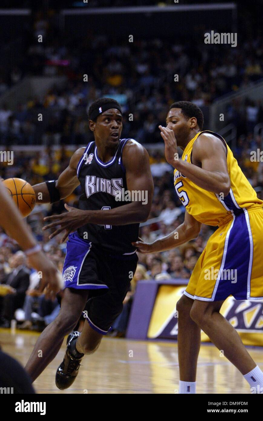 f14549d7afb Chris Webber drives to the basket against Robert Horry in the first quarter  in game three