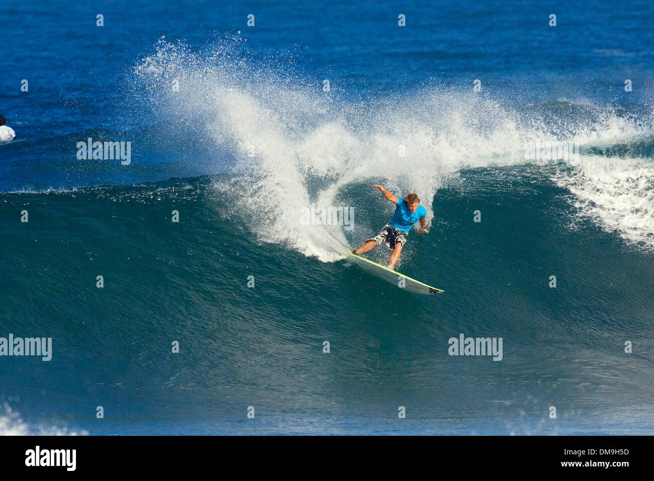 Nov 17, 2005; Haleiwa, HI, USA; JAY THOMPSON (Sunshine Coast, Aus) (pictured) surfed a strong heat in round two of the OP Pro at Haleiwa, Hawaii today. Thompson placed a narrow second to Daniel Ross (Aus) (16.14 out of 20 to RossÕs 17.24) to advance to round three (round of 64) eliminating Greg Long (USA) and Drew Courtney (Aus) from the event. The OP Pro is the first jewel in the  - Stock Image