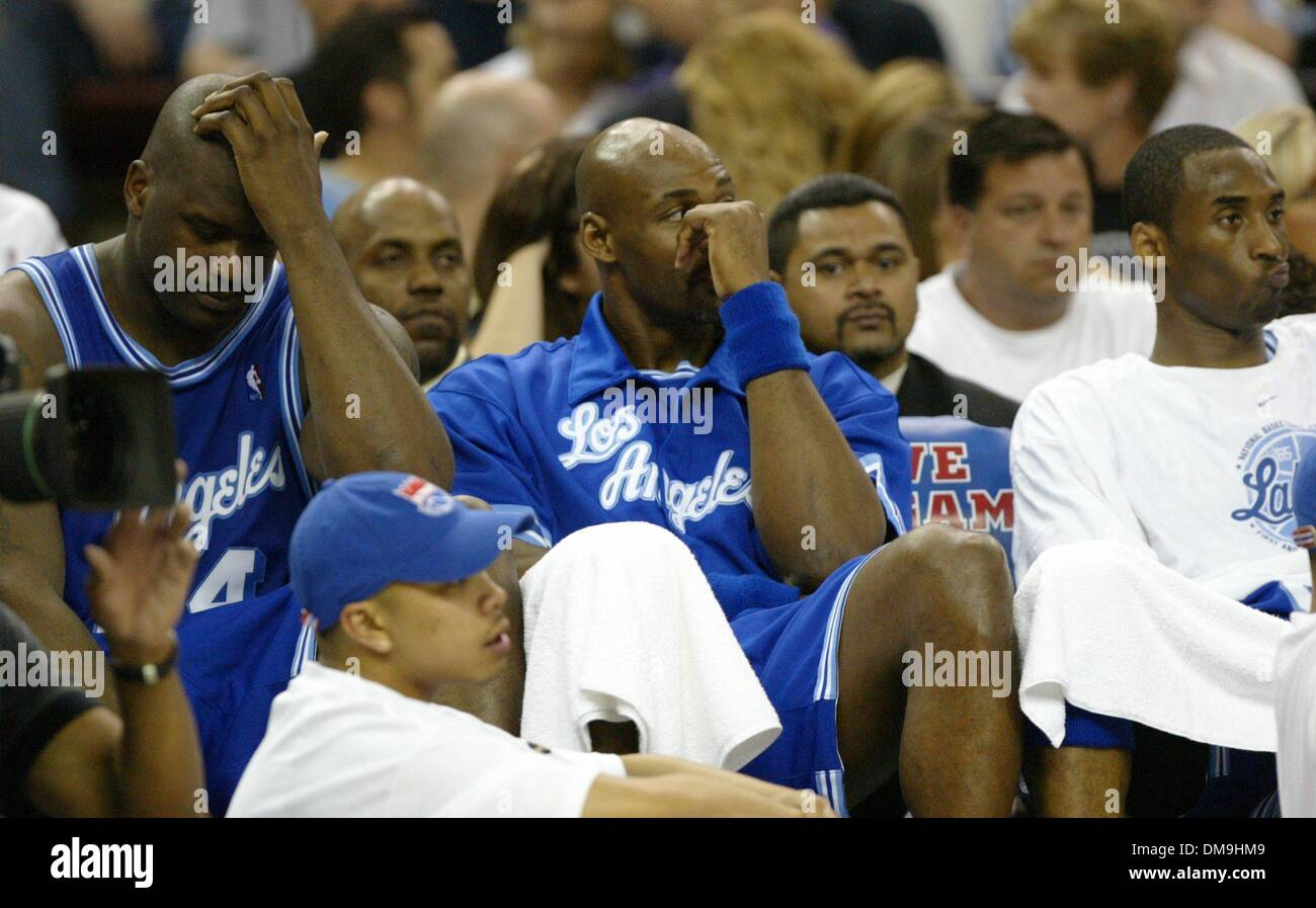 0b4a99f4 Shaquille O'Neal, Karl Malone and Kobe Byrant watch the fourth quarter from  the