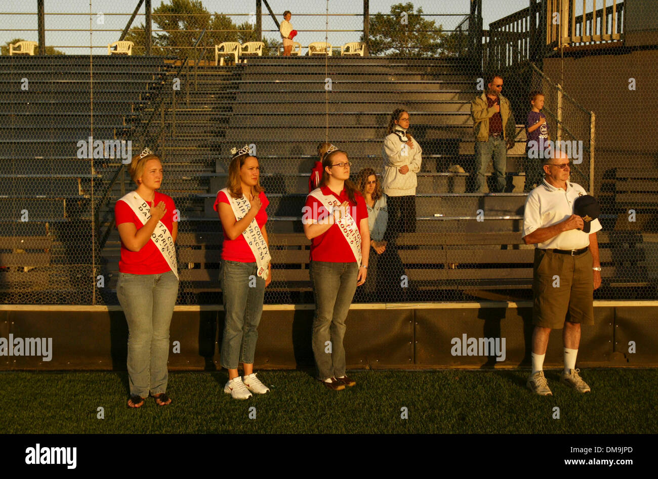 Jul 27, 2005; Miesville, MN, USA; Three Dakota County Dairy Princesses were on the field during the national anthem before the Miesville Mudhens met the Eau Claire Cavaliers in July of last year. They are, from left, Tanya Reuter, Allison Brand, and Sara Bremer. The Miesville Mudhens are a classic 'Townball' amateur baseball team that plays their home games at Jack Ruhr Field in Mi - Stock Image