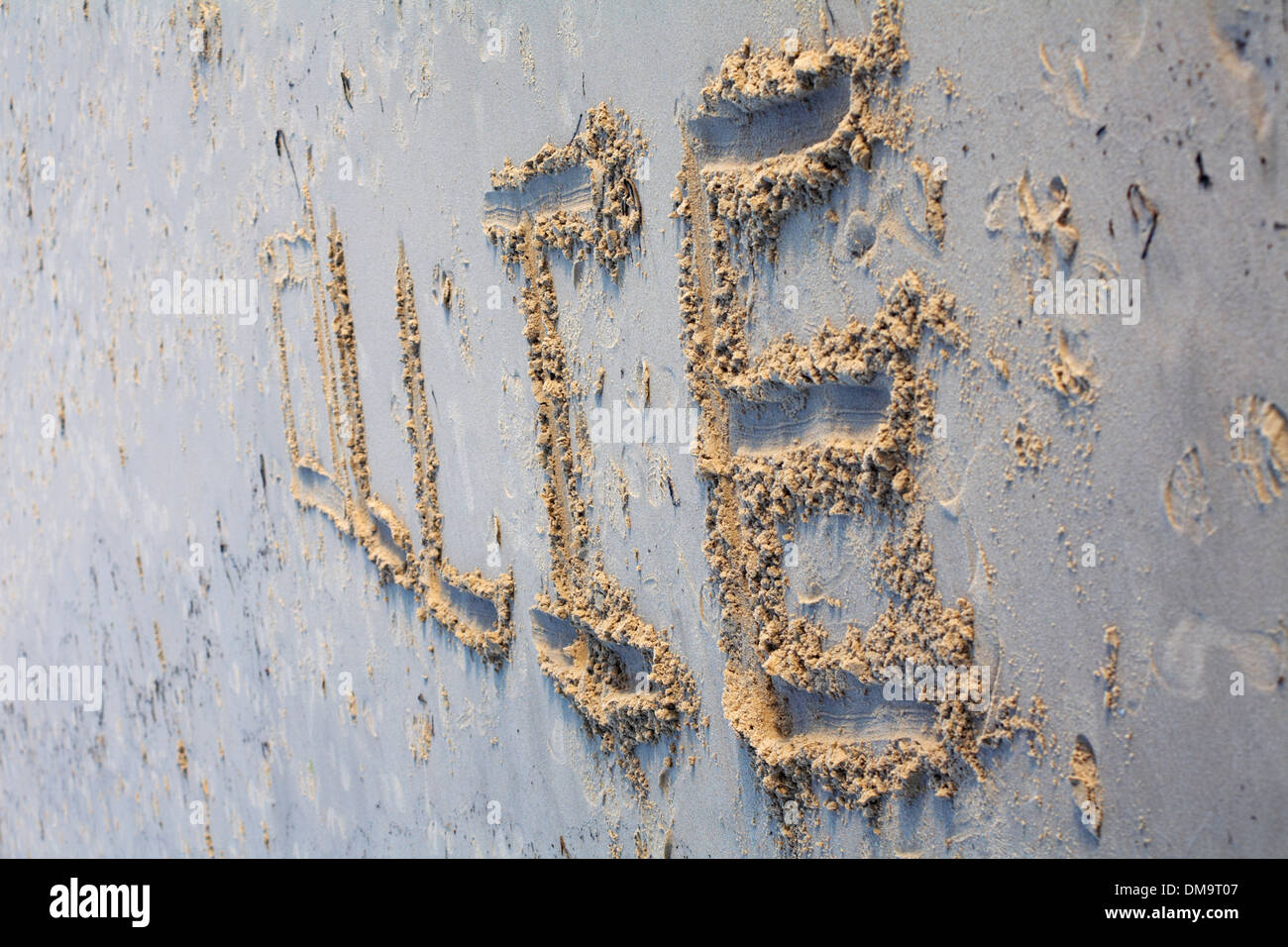 Ollie - name written in sand on the beach - Stock Image
