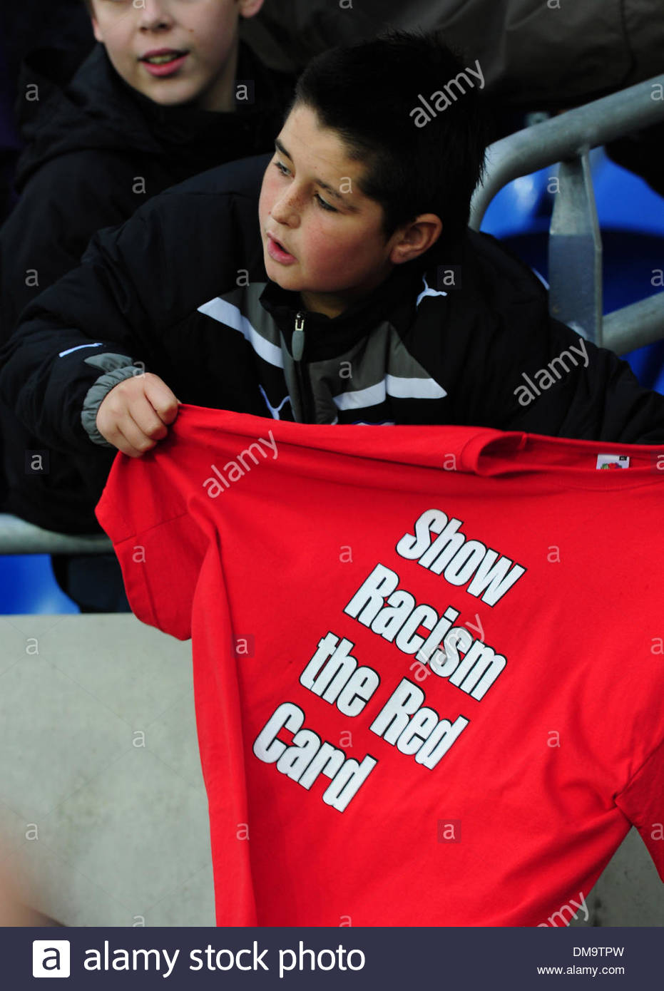 A young fan holds an anti racism t-shirt..International Friendly..Wales v Scotland..14th November, 2009.(Credit Image: © Simon Bellis/Sportimage/Cal Sport Media) - Stock Image