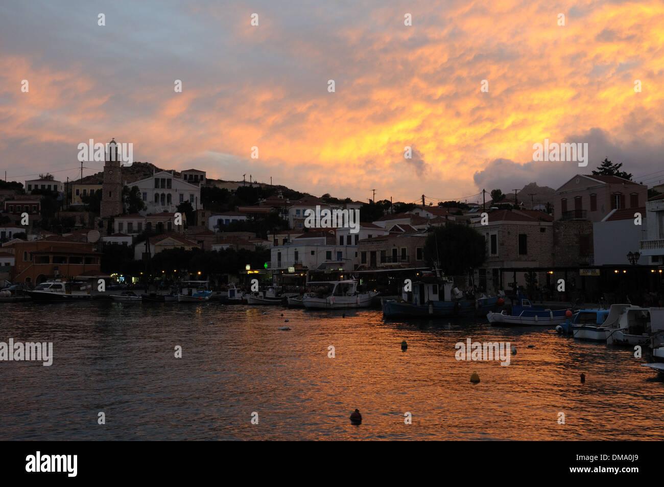 Sunset over Emborios Halki  Chalki Greek island The Dodecanese Greece - Stock Image