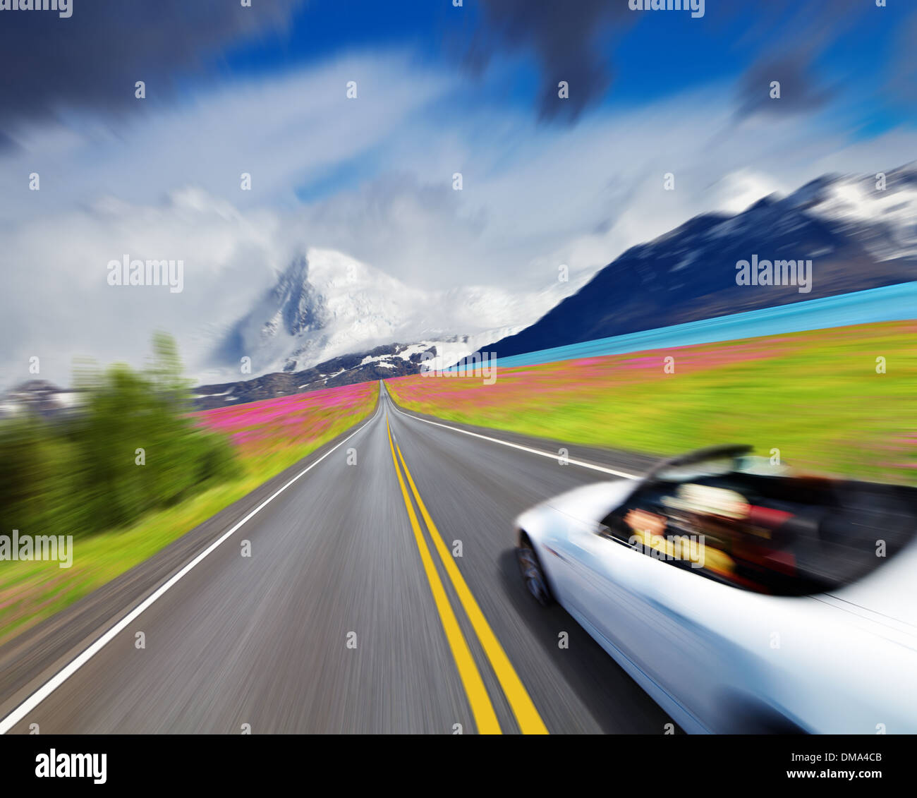 Mountain landscape with road and sports car in motion blur - Stock Image