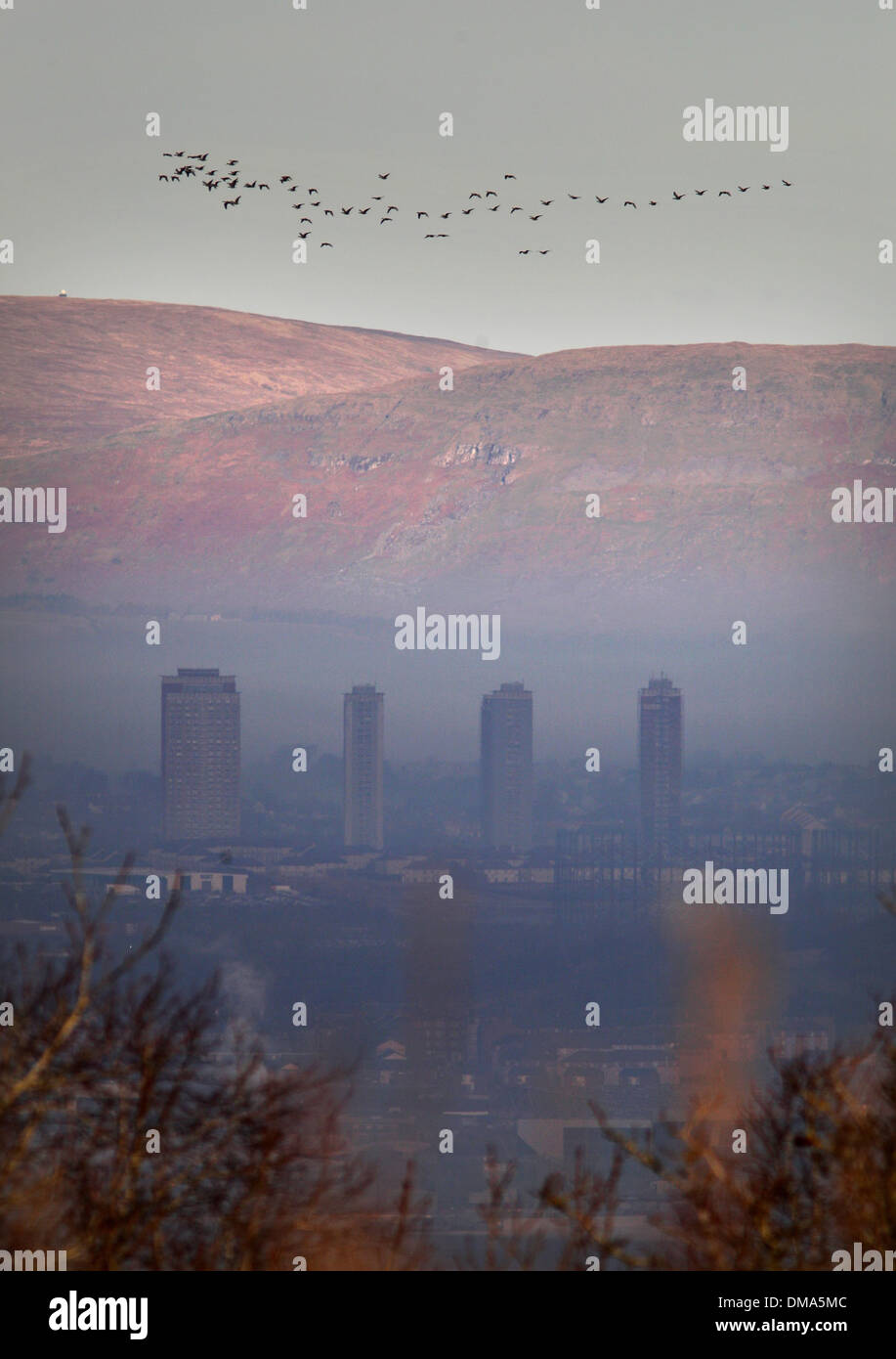 A view over Glasgow shrouded in freezing fog from the Caithkin Braes above the city. November 25 2013. Autumnal mist weather. - Stock Image