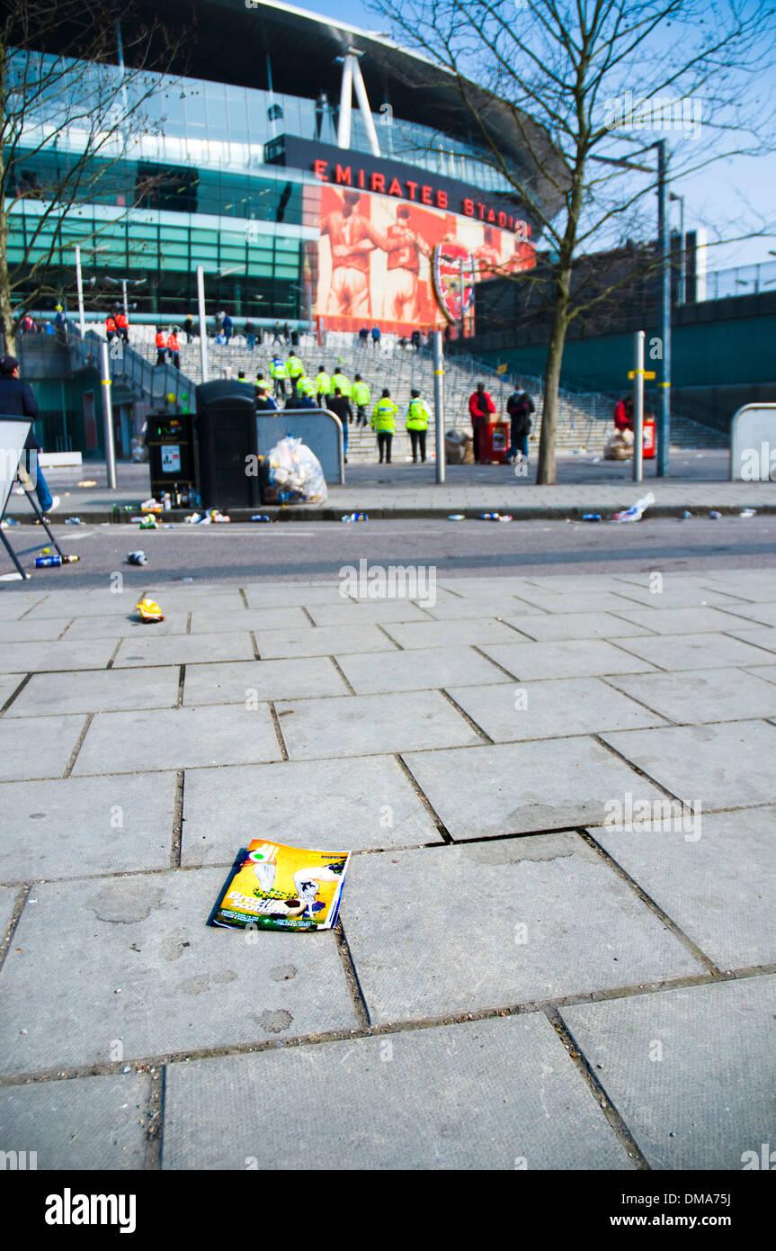 A disgarded magazine outside of Arsenal's Emirates Stadium - Stock Image
