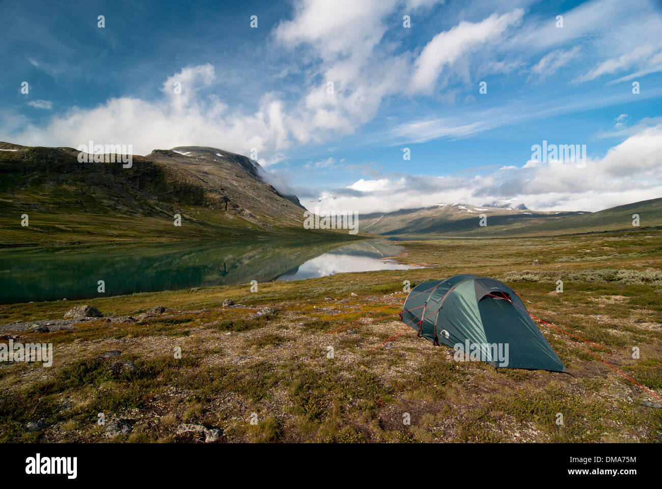 Tent on a mountain lake, national park Jotunheimen, Norway - Stock Image