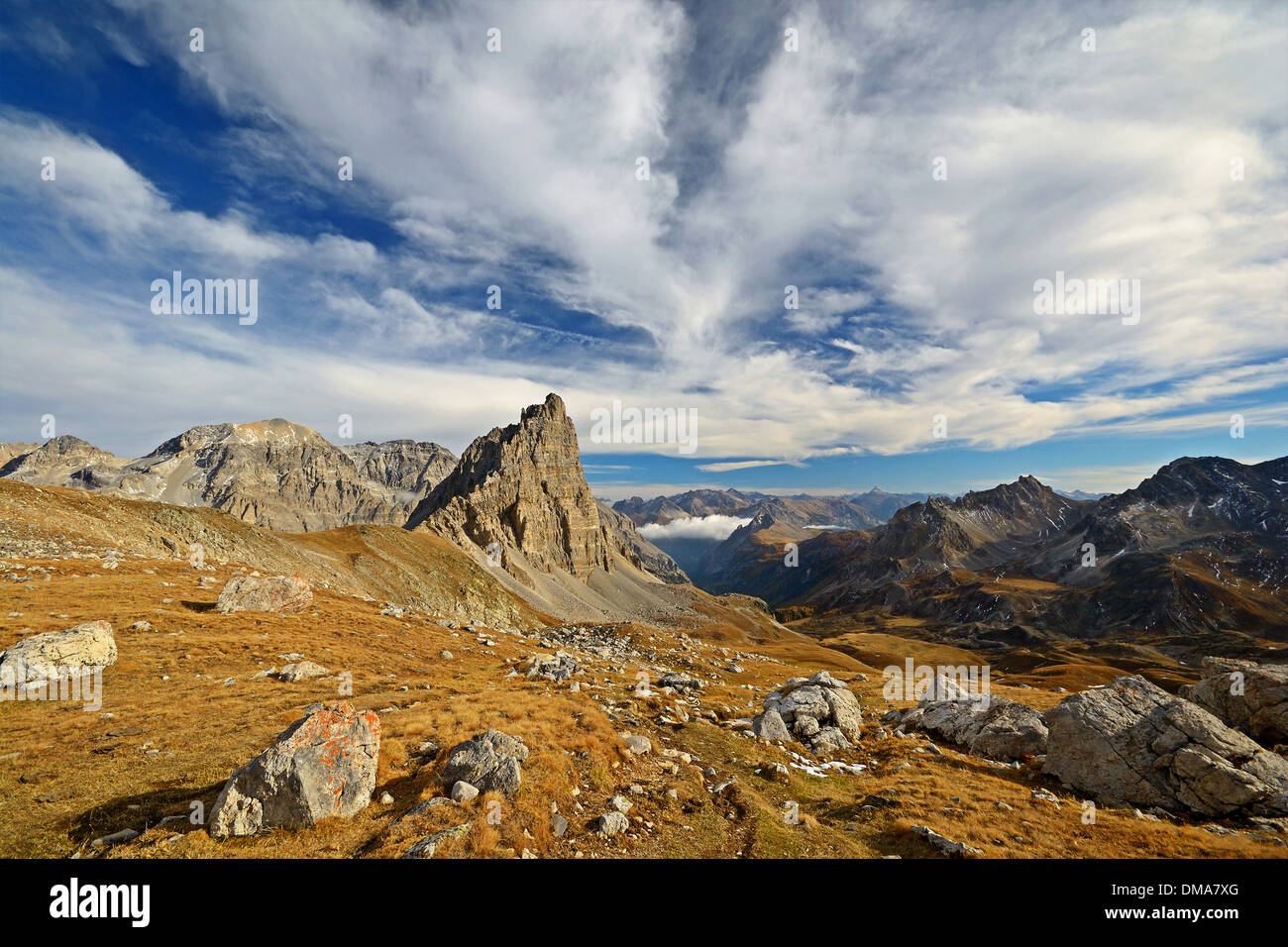 Mountain footpath leading up to the top of M. Thabor (3178 m) in afternoon light on barren terrain, italian-french Stock Photo