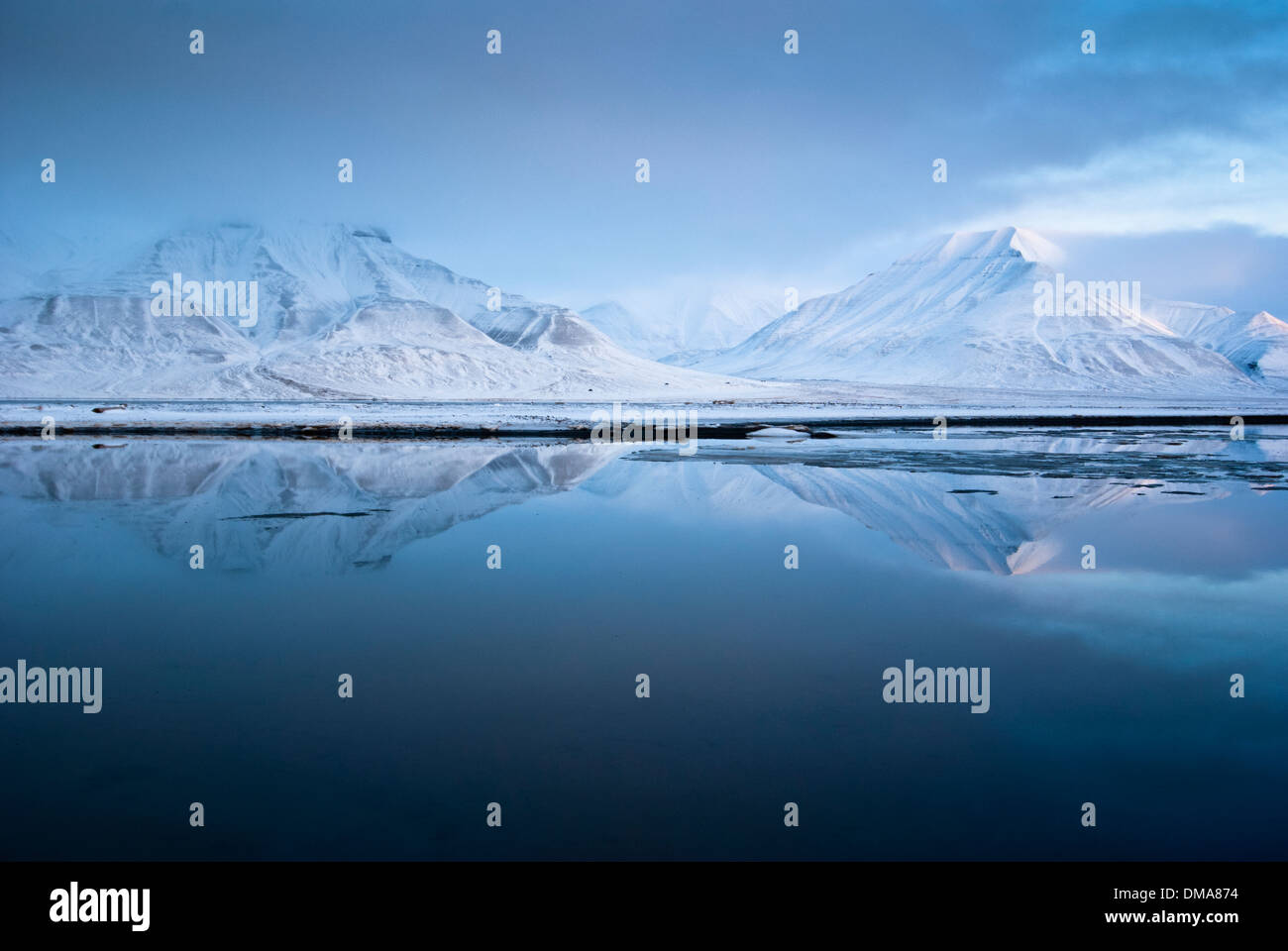 Massif of Adventdalen and Isfjorden at dusk, Spitsbergen, Norway - Stock Image
