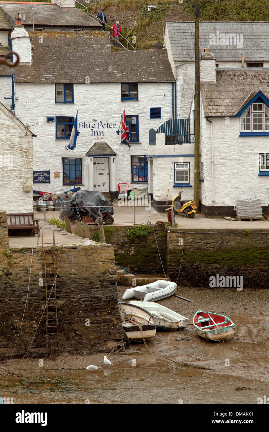 The Blue Peter Inn, built into the cliff by the outer quay, Polperro, Cornwall, UK - Stock Image