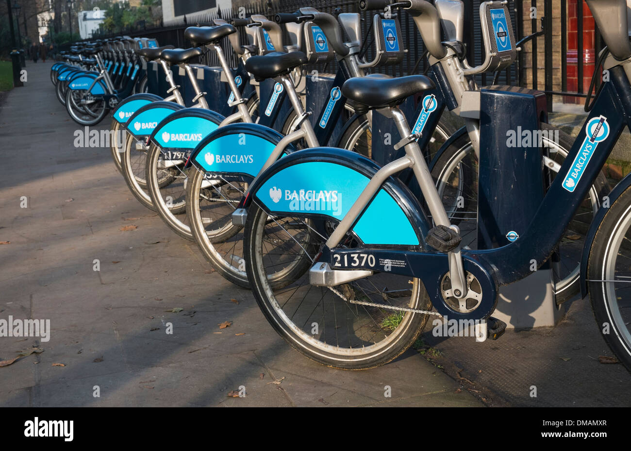 Line of parked Barclays hire bicycles  at docking station London UK - Stock Image