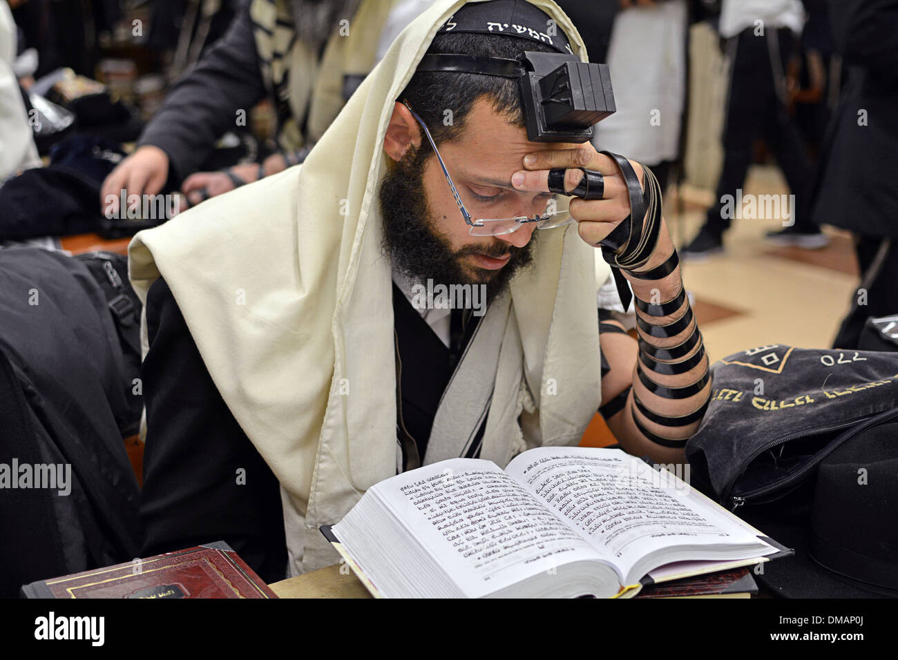 A religious young Jewish man with a beard at morning prayers at the Lubavitch headquarters in Brooklyn, New York - Stock Image
