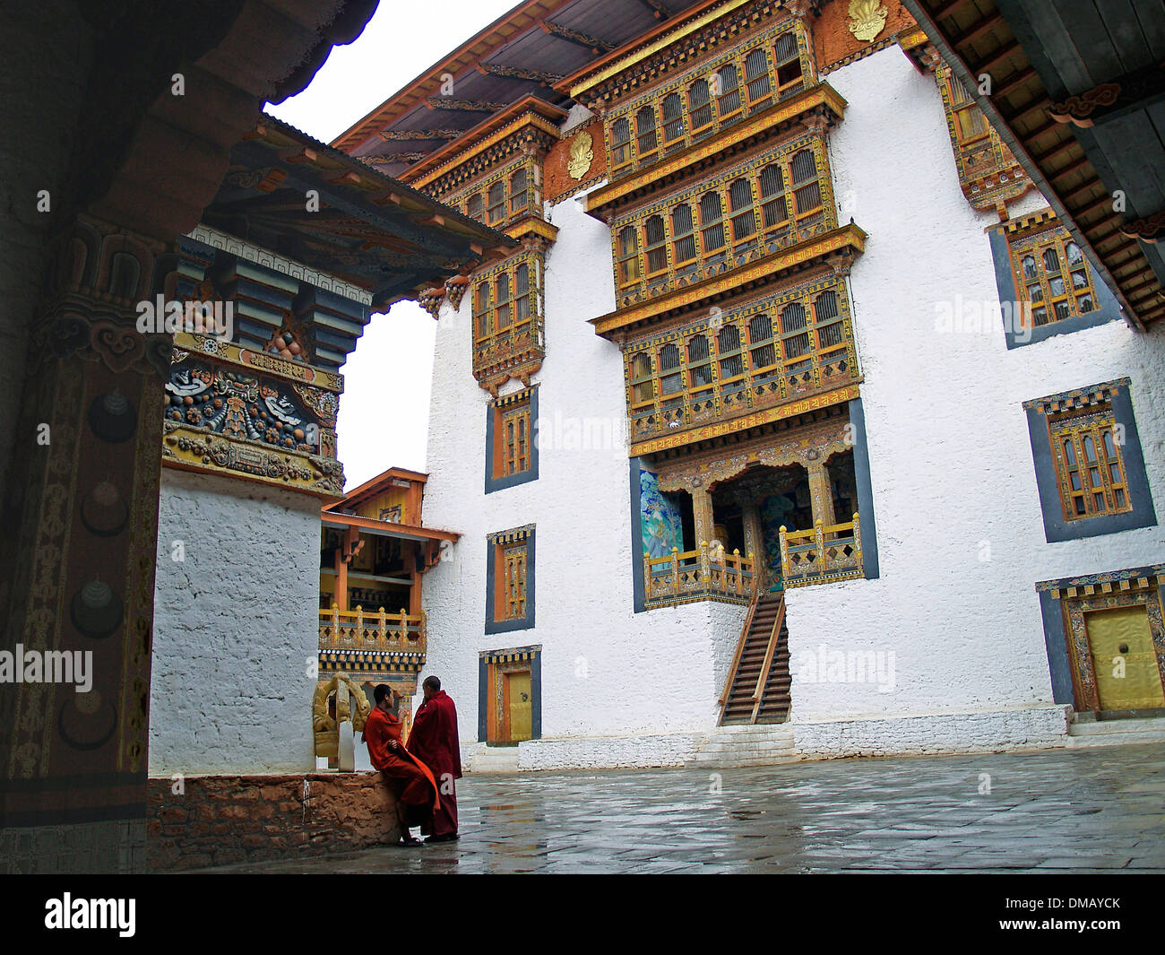 Two monks in the courtyard of the Punakha Dzong,Bhutan Stock Photo