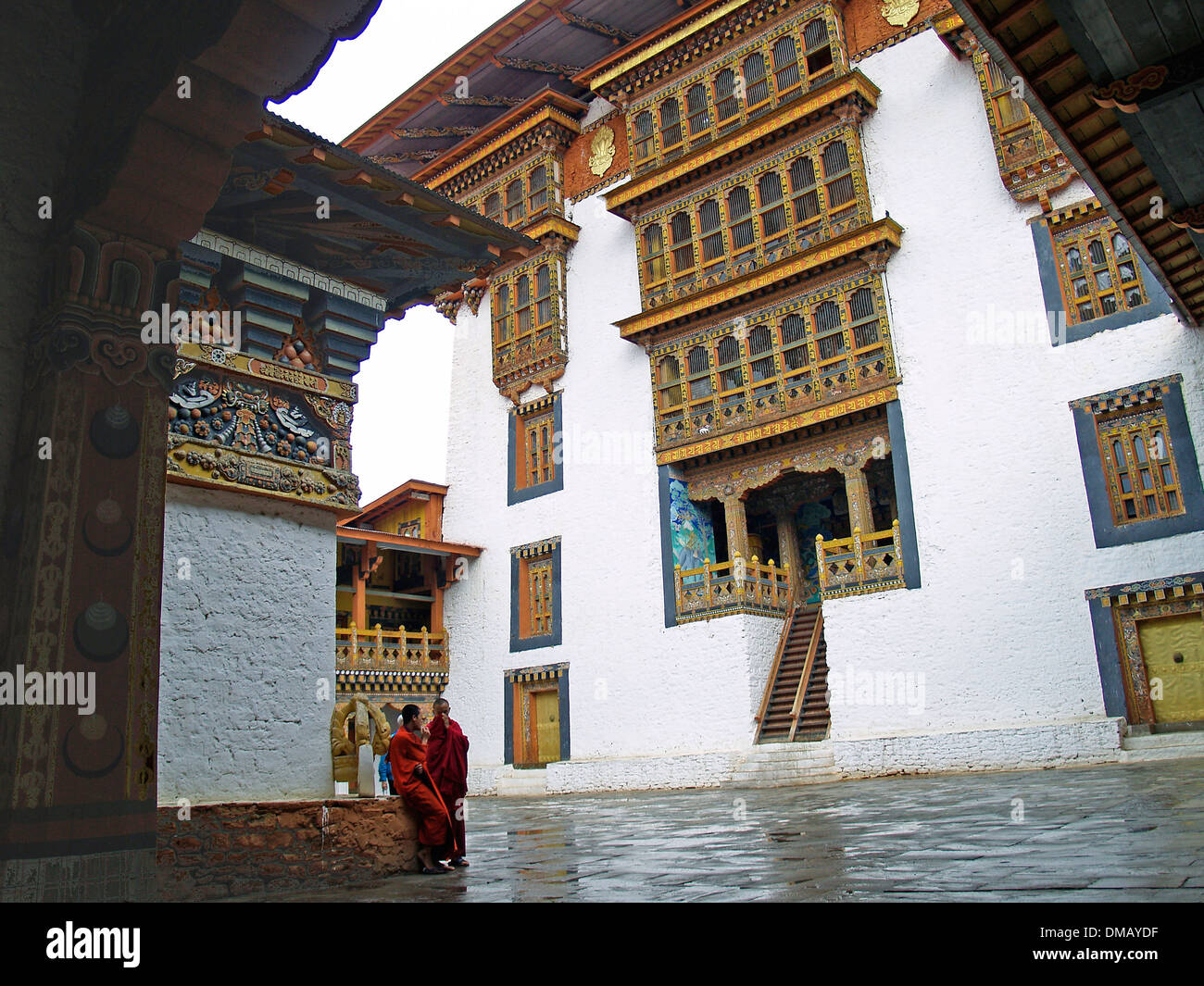 Two monks in the interior coutyard of the Punakha Dzong,Bhutan Stock Photo