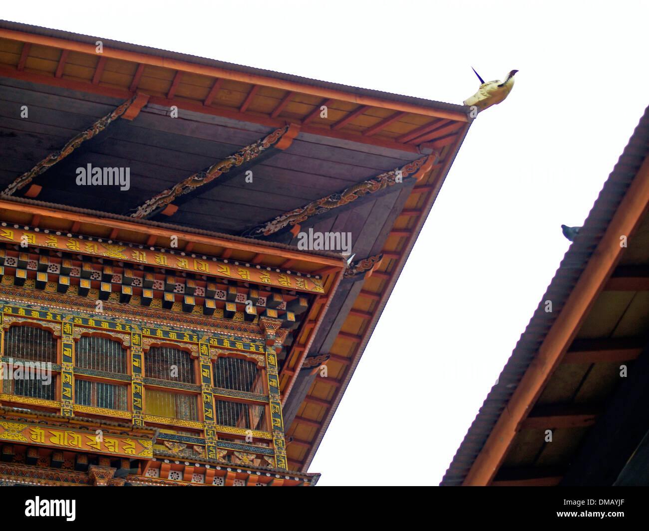 Roof lines and a gargoyle,Punakha Dzong,Bhutan - Stock Image