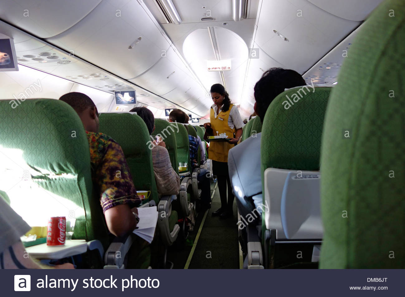 An air stewardess serves coffee on Ethiopian Airlines flight - Stock Image