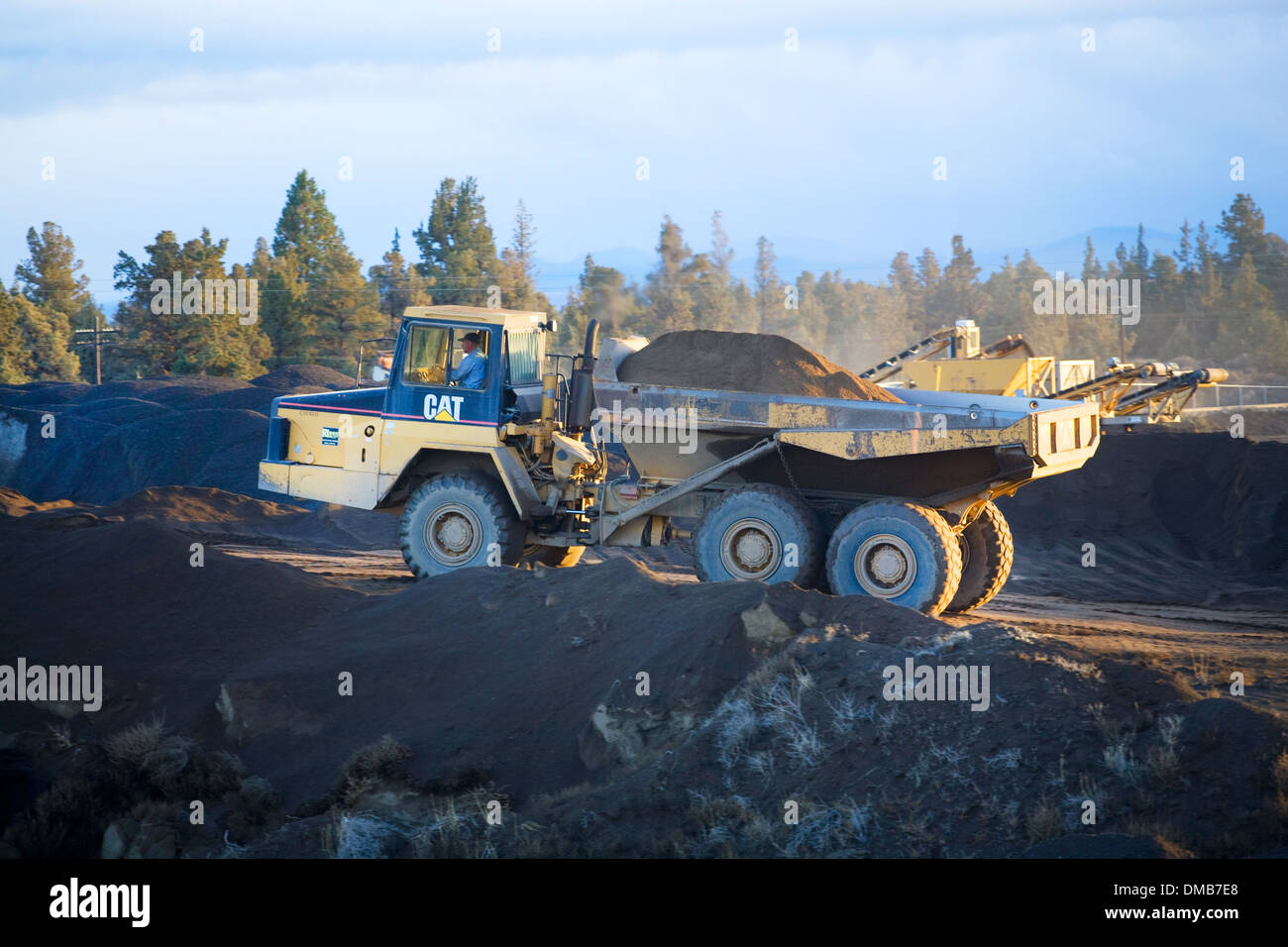 A giant Caterpillar dump truck moving earth - Stock Image
