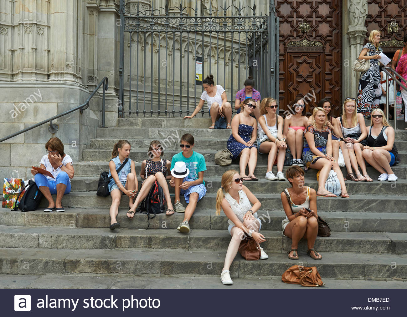 Tourists taking photographs on Top Deck of a Tourist Trip Bus in Barcelona in Catalunya in Spain in Europe - Stock Image