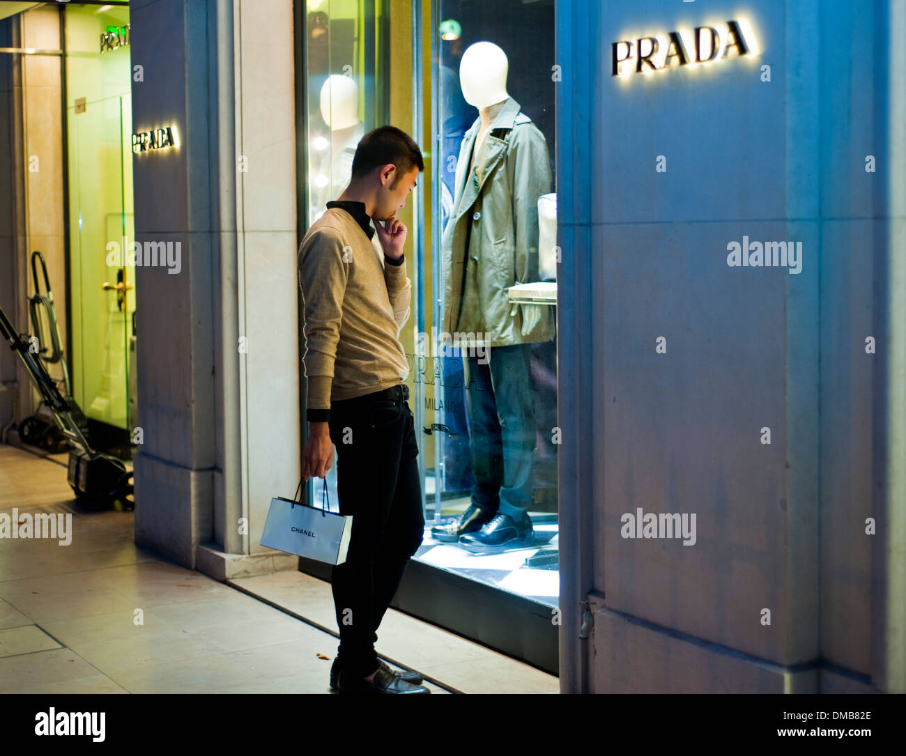 Paris, France, Young Chinese Man, Shopping Street, Luxury Brand Store, Prada, Shop Front WIndow, on Avenue Montaigne Stock Photo