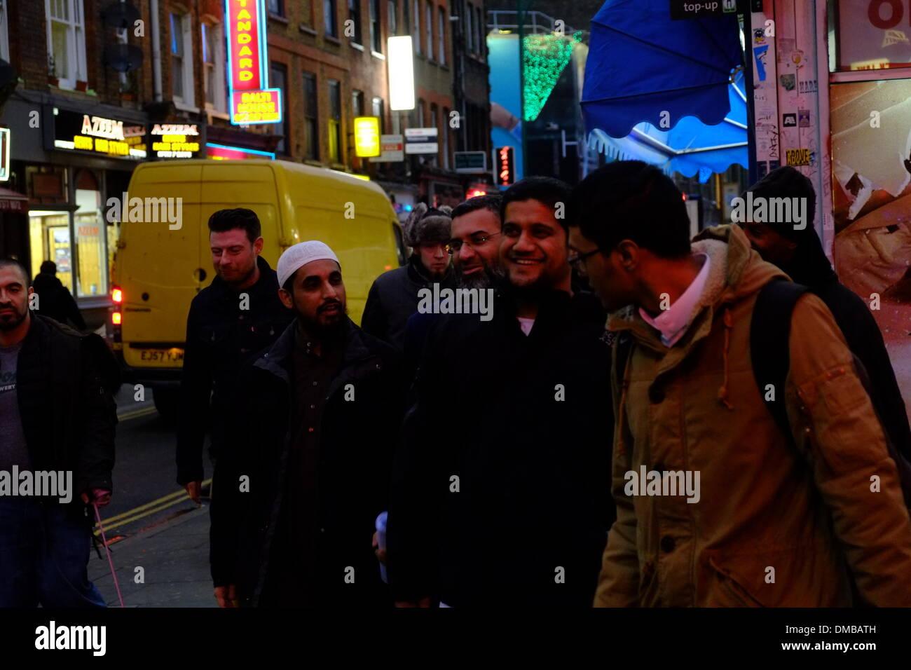 London, UK. 13th December 2013. Muslim extremist march calling for ban on alcohol, Brick Lane, London Credit:  Rachel Megawhat/Alamy Live News - Stock Image