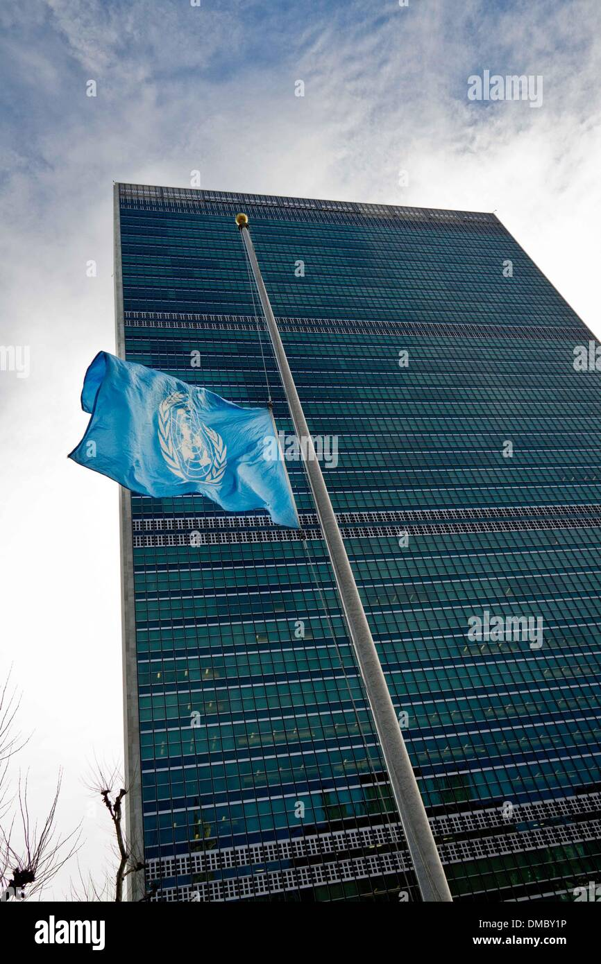 New York, UN headquarters in New York. 13th Dec, 2013. The UN flag flies at half mast as a mark of respect for the funeral ceremony of Nelson Mandela, at the UN headquarters in New York, on Dec. 13, 2013. The funeral will be held on Sunday, Dec. 15. © Niu Xiaolei/Xinhua/Alamy Live News - Stock Image