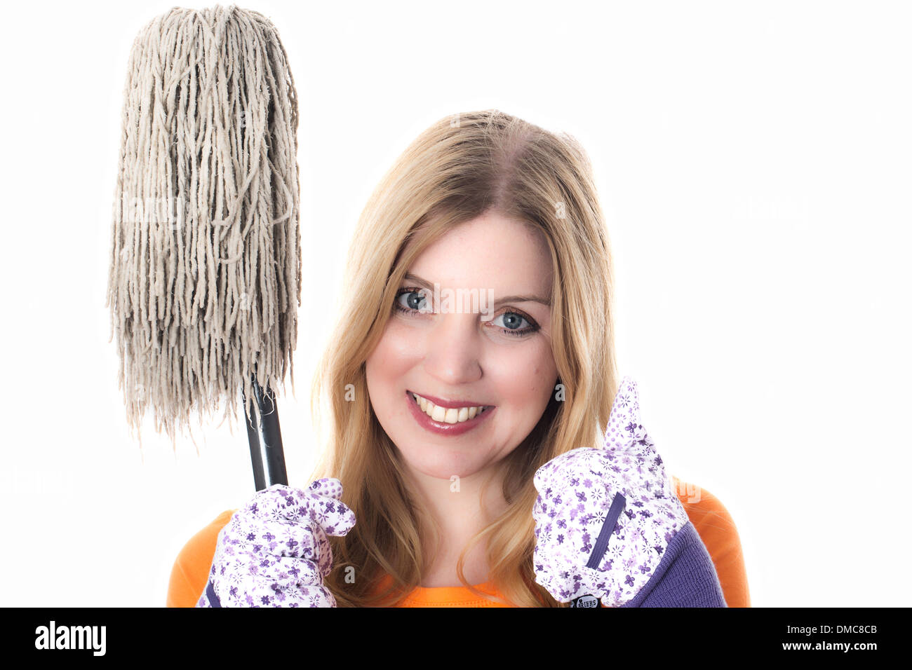 Young Woman Holding a Mop - Stock Image