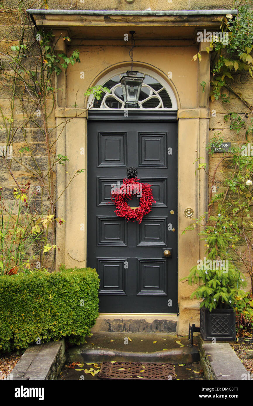 Christmas Garland On Front Door Of An English Country Home In The Village  Of Ashford In The Water, Peak District, Derbyshire UK