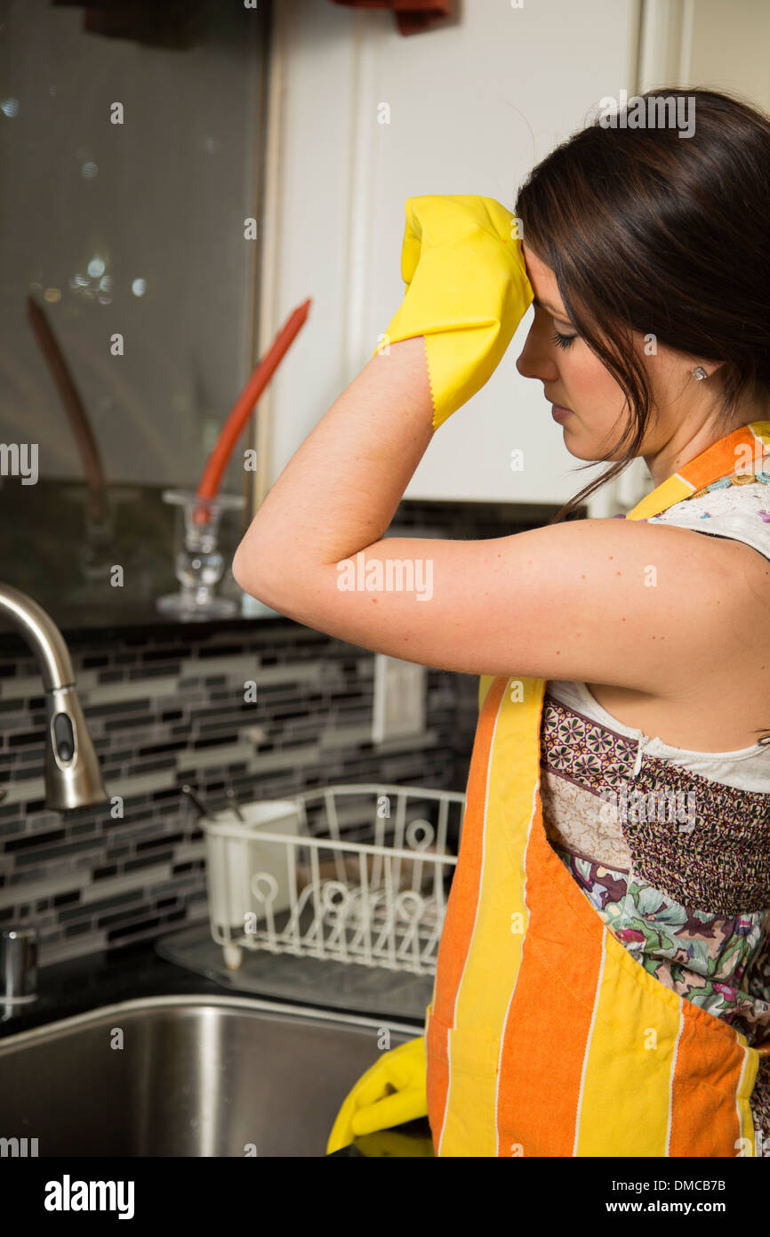 Woman tired of cleaning the dishes - Stock Image