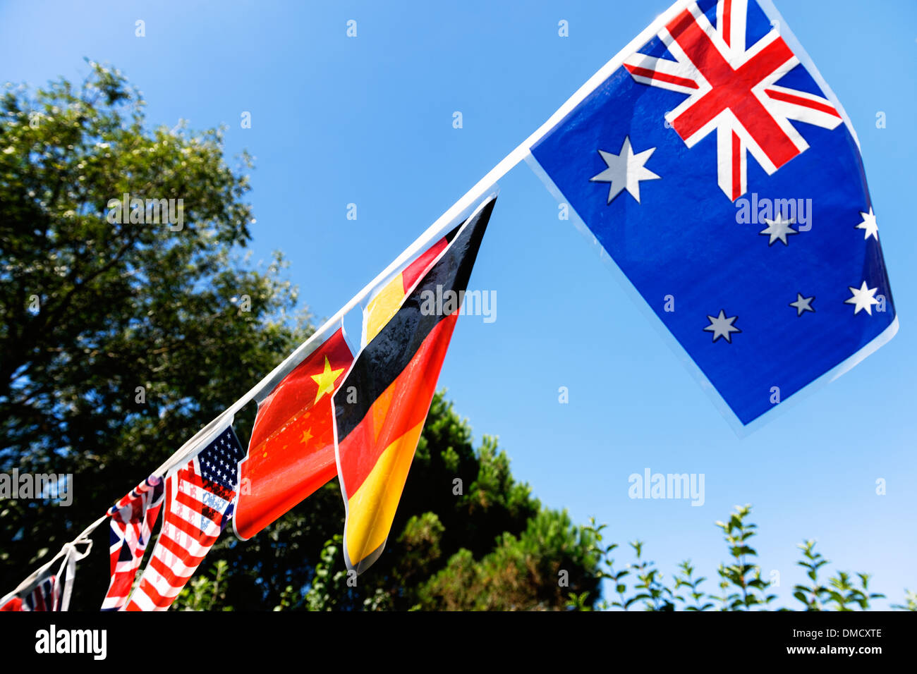 Multinational flag bunting at a garden party. - Stock Image