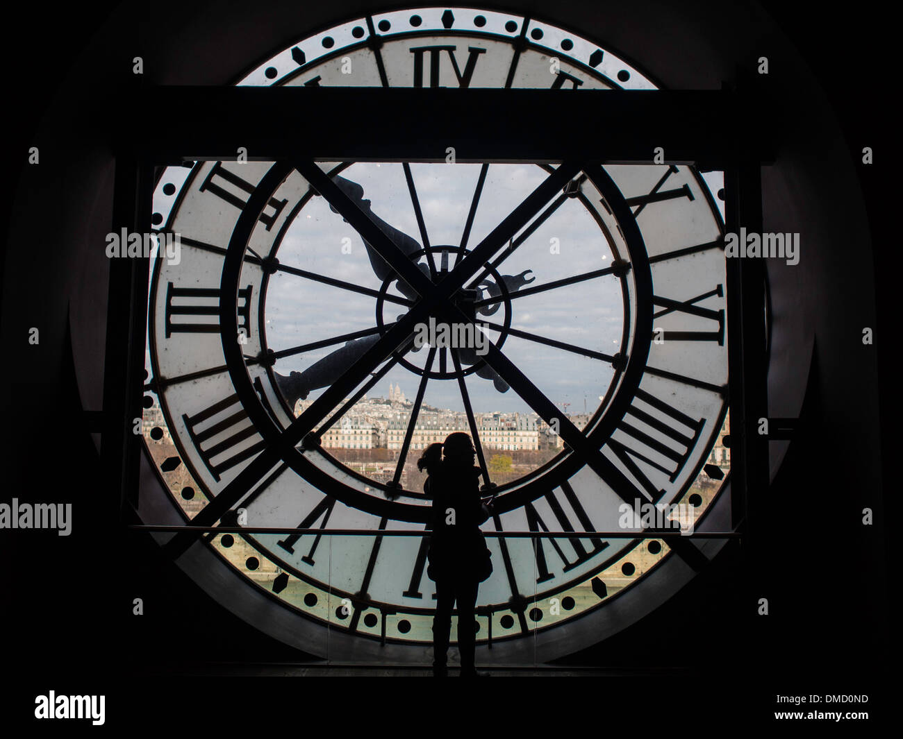 Behind the clock at Musée d'Orsay with Paris in background - Stock Image