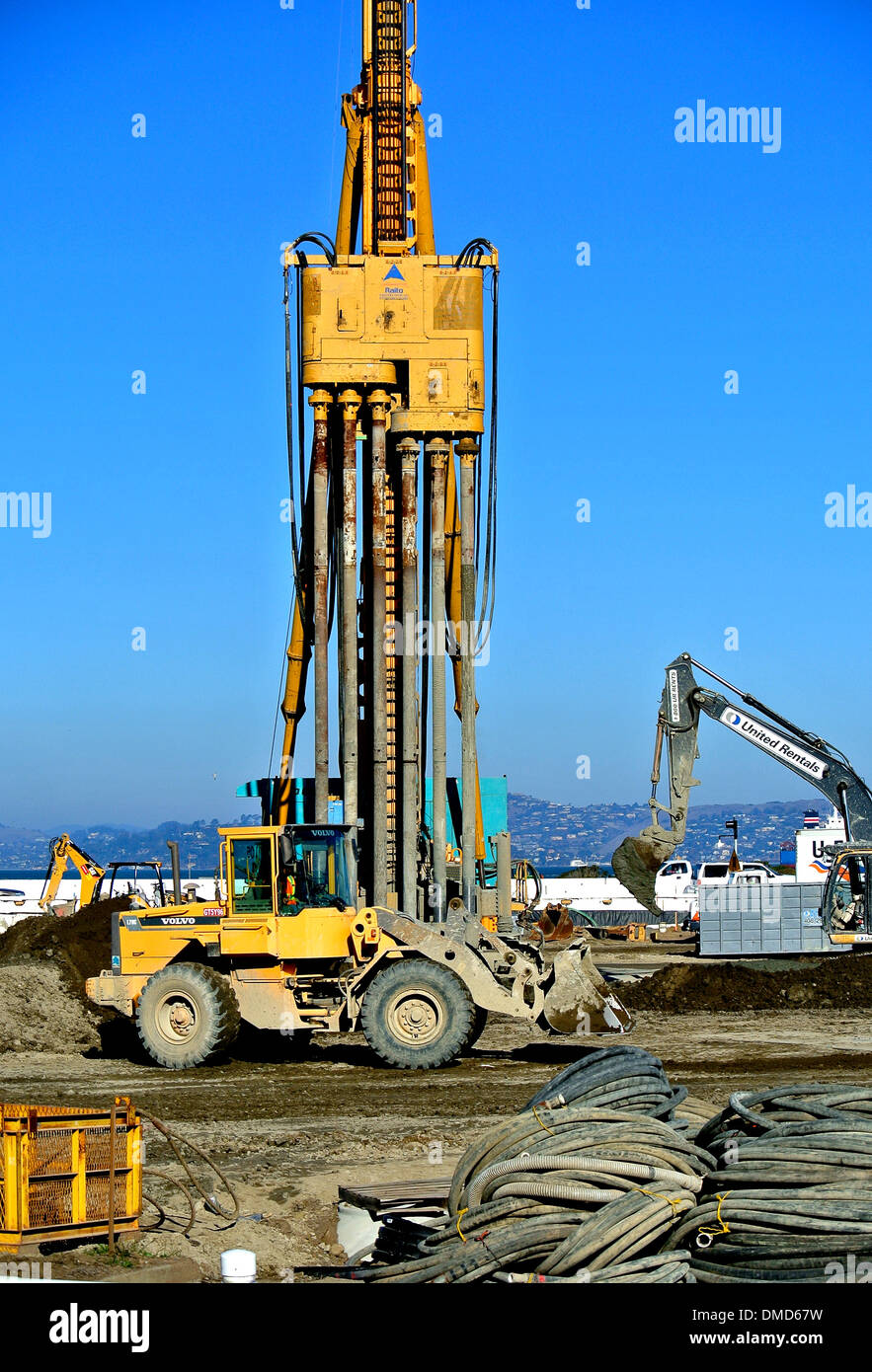 concrete mixer and heavy equipment on Presidio Parkway construction site in San Francisco - Stock Image