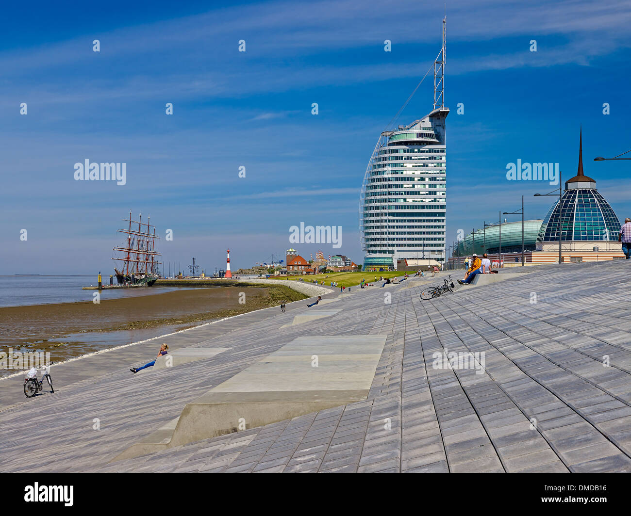 Dike with Atlantic Sail City Hotel and Mediterraneo, Bremerhaven, Bremen, Germany - Stock Image
