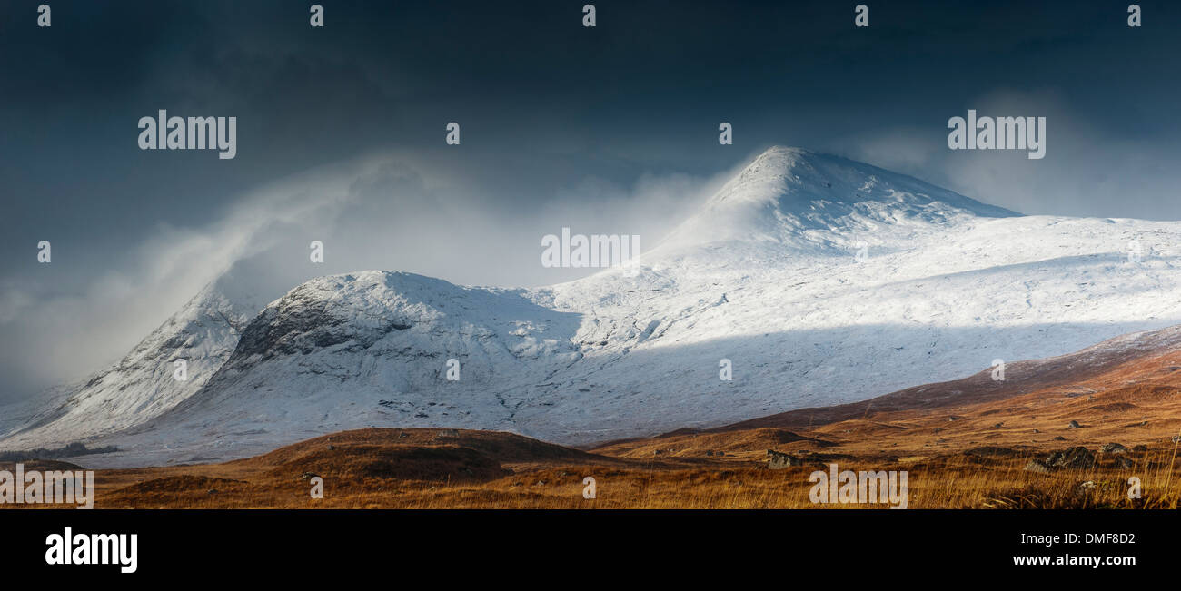 Clach Leathad hidden in cloud with the summit of Meall a Bhuiridh just clear of clouds viewed from Rannoch moor glencoe - Stock Image