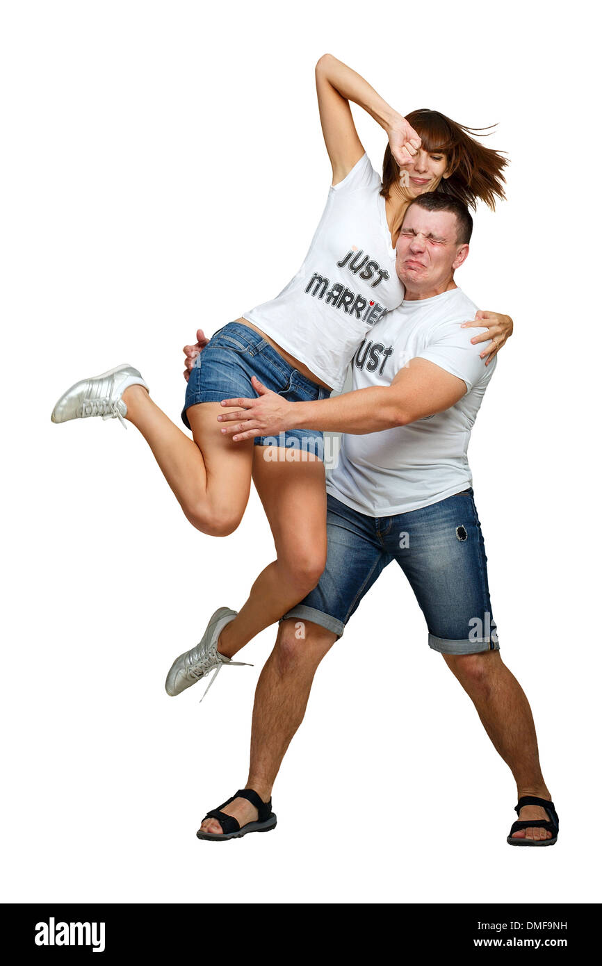 Woman punching her boyfriend in the face isolated on white background - Stock Image