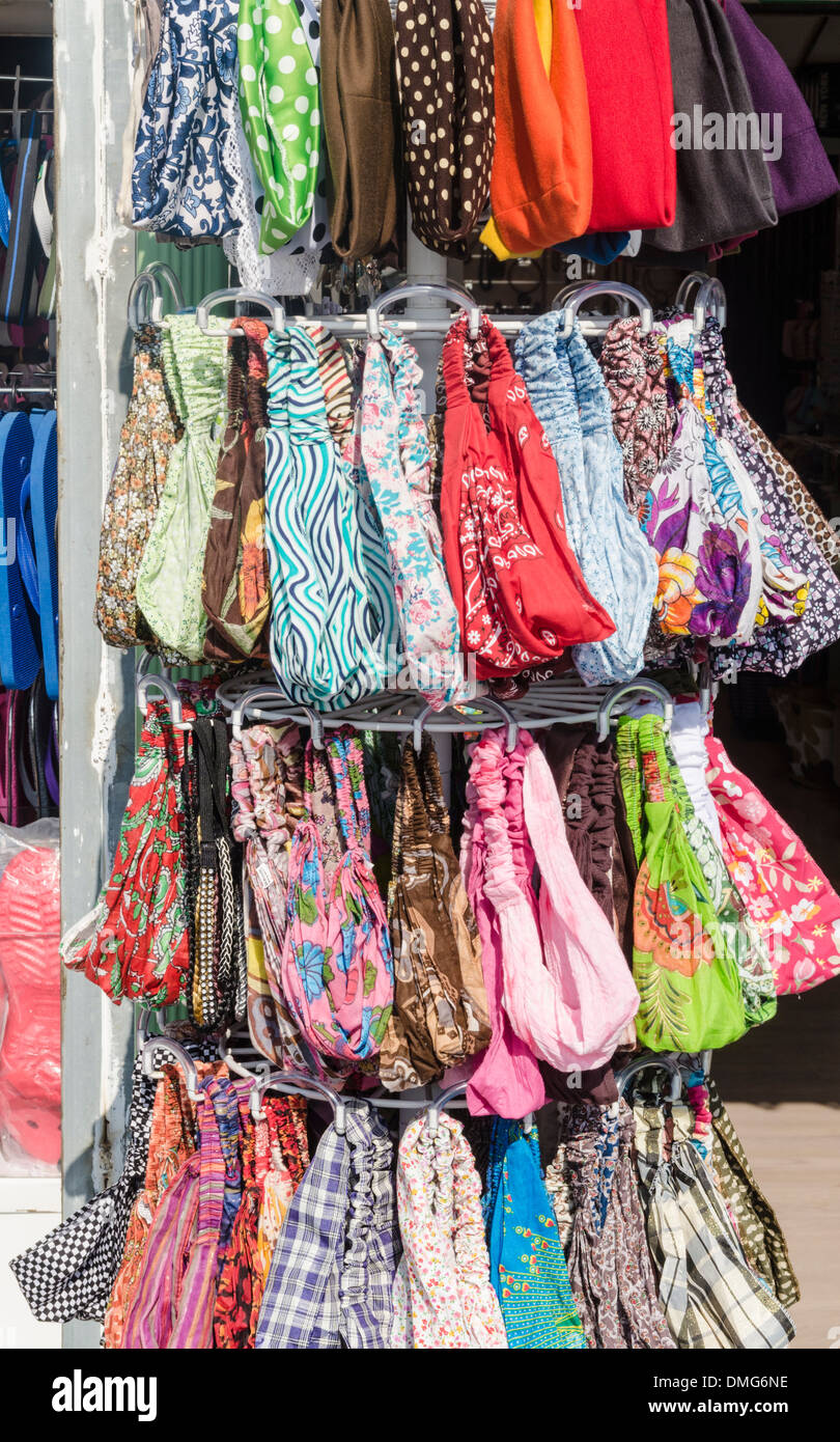 Bandanas on a rack outside a shop in the seaside town of Le Grau d'Agde, Herault, Languedoc-Roussillon, France - Stock Image