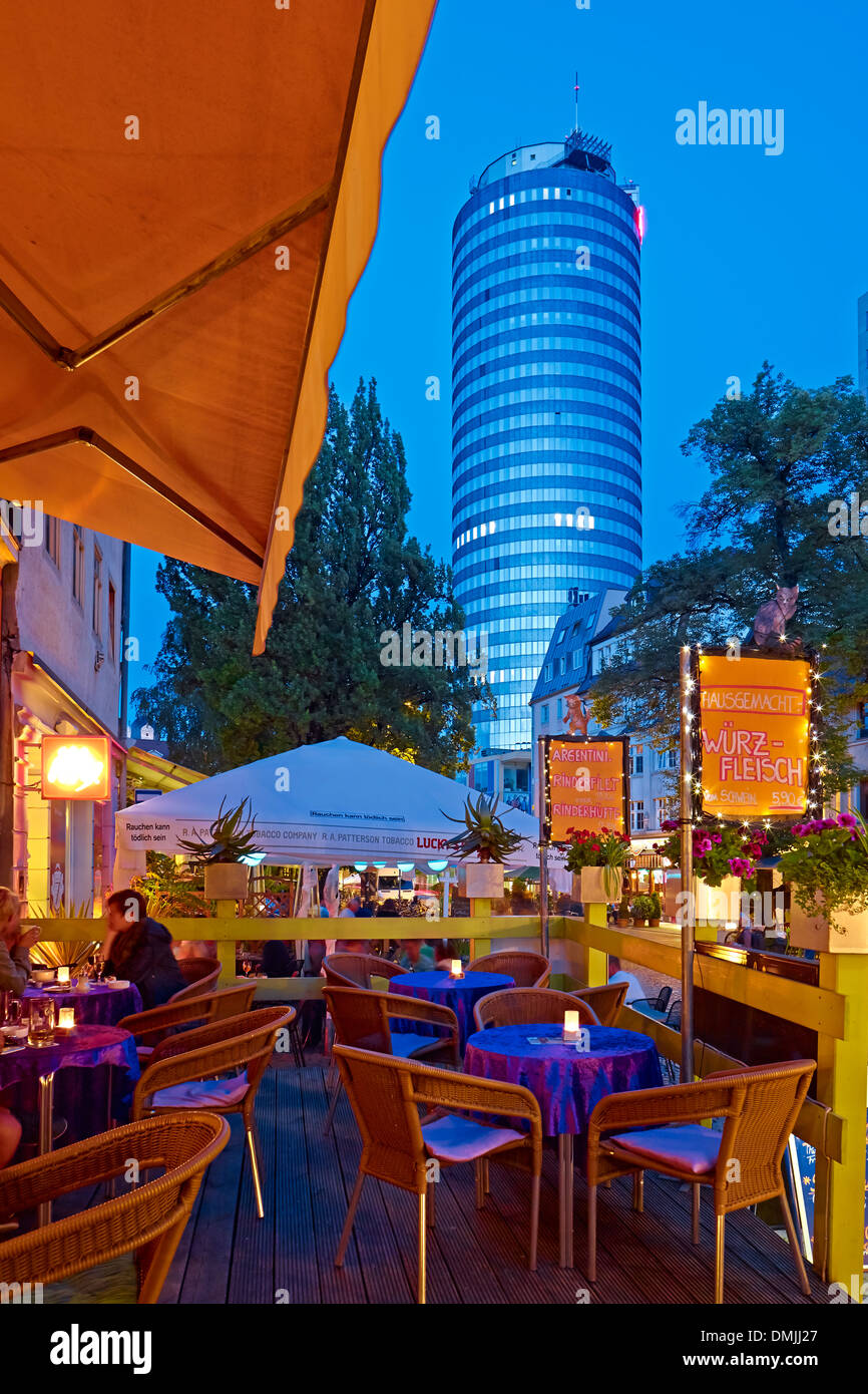 Pub scene in the Wagnergasse with Intershop Tower in Jena., Thuringia, Germany - Stock Image