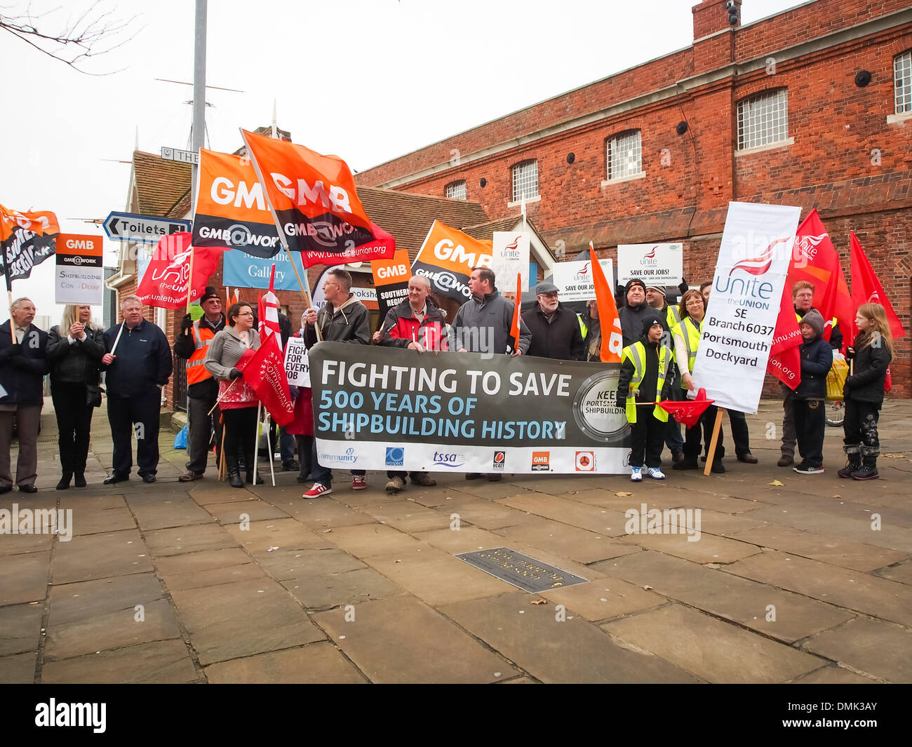 Portsmouth, UK. 14th December 2013. Hundreds of BAE workers protest against the possible closure of the BAE shipbuilding facility. The protesters met outside of Portsmouth naval dockyard where there was heavy union representation. Credit:  simon evans/Alamy Live News - Stock Image
