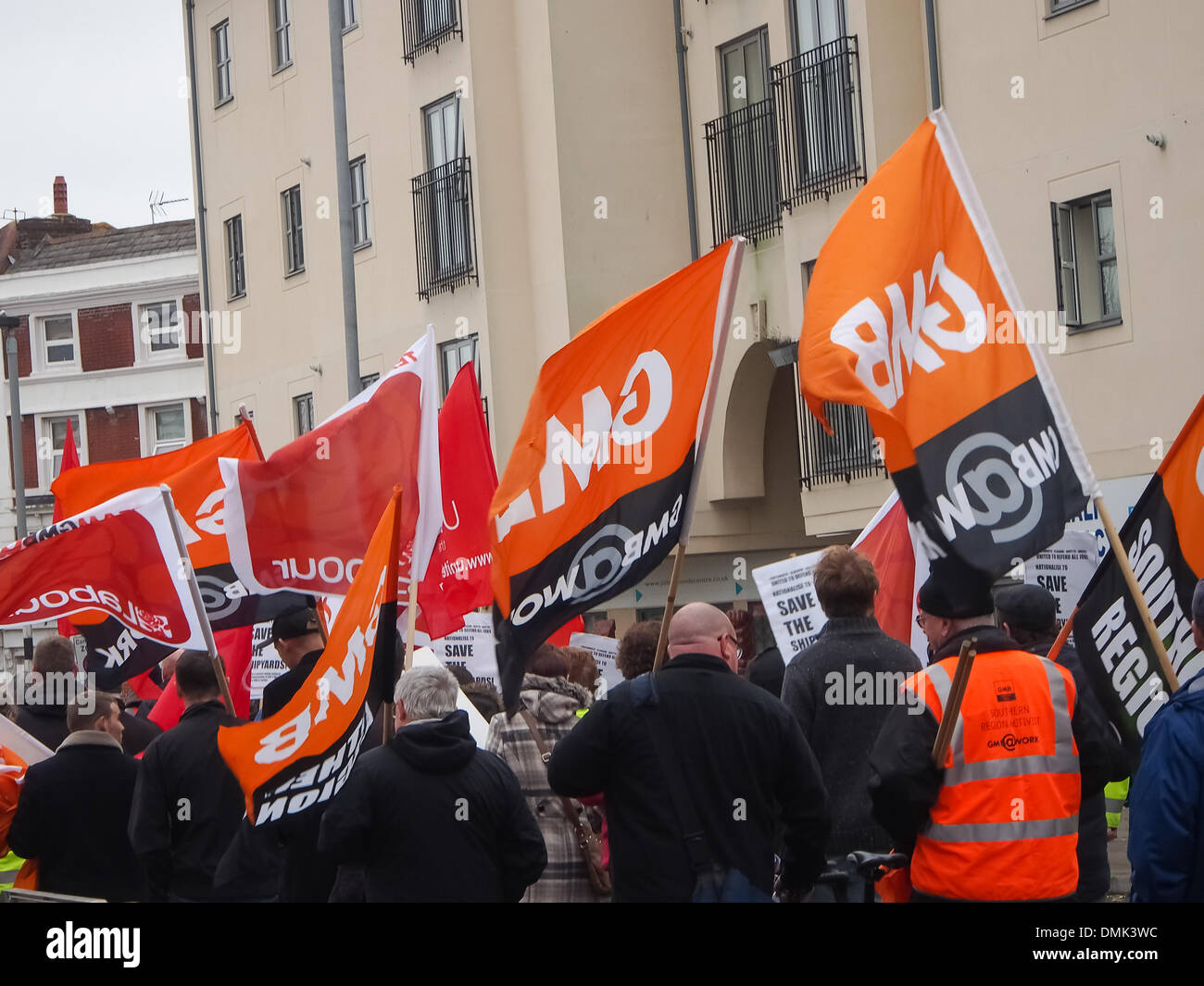 Portsmouth, UK. 14th December 2013. Hundreds of BAE workers protest against the possible closure of the BAE shipbuilding facility. Trade unions were heavily represented at the Protest with many workers carrying union banners and flags Credit:  simon evans/Alamy Live News - Stock Image