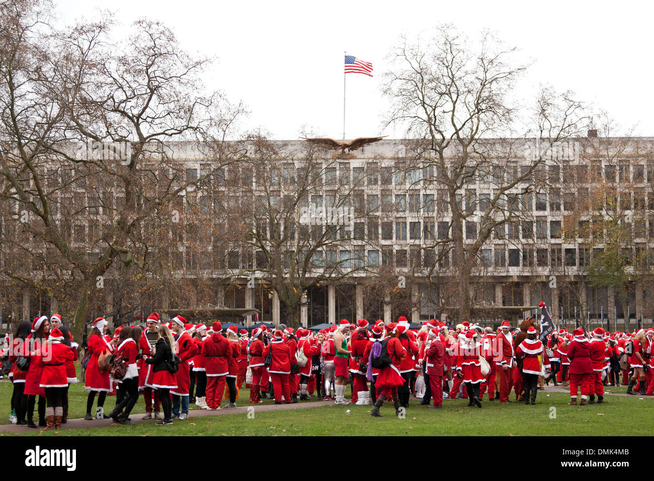 London, UK. 14th of December 2013 Annual Santa Con gather outside the US embassy. Every year in December thousands Stock Photo