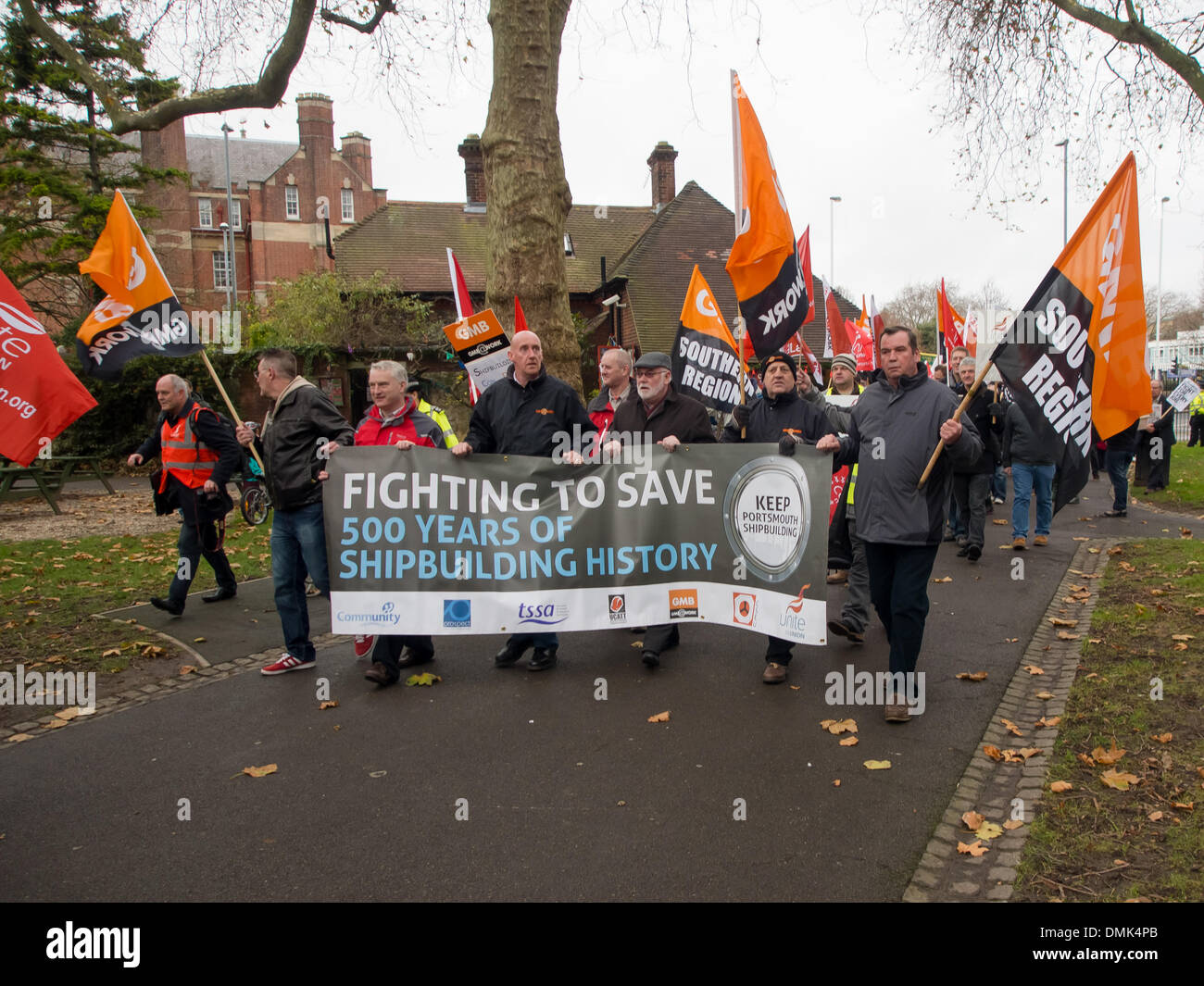 Portsmouth, UK. 14th December 2013. Hundreds of BAE workers protest against the possible closure of the BAE shipbuilding facility. Union members and workers marched through the city streets and through Victoria park to the Guildhall. Credit:  simon evans/Alamy Live News - Stock Image