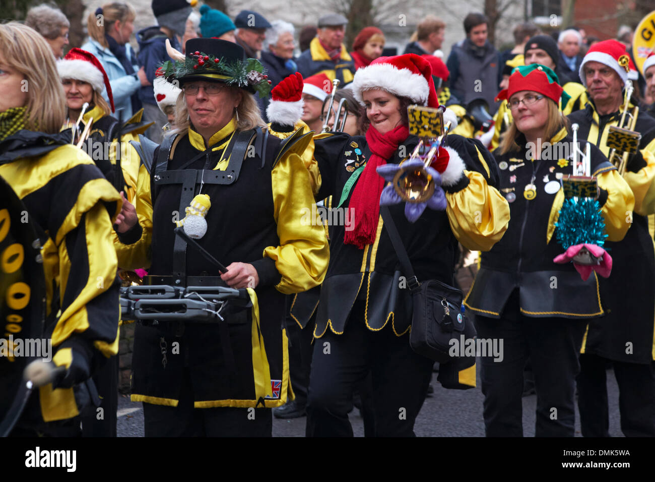 Wimborne, Dorset, UK. 14th December 2013. Crowds turn out to watch the 25th Wimborne Save The Children Christmas Parade. Gugge 2000, Gugge2000, Swiss style guggemusik band marching band. Credit:  Carolyn Jenkins/Alamy Live News Stock Photo