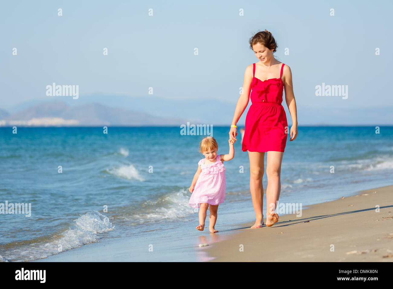 Mother and daughter on the beach - Stock Image