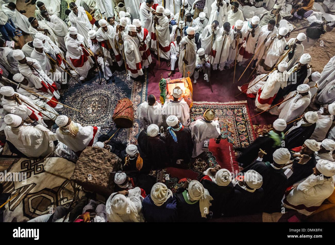 Priest celebrating Orthodox Easter inside a temple, Lalibela, Ethiopia, Africa - Stock Image